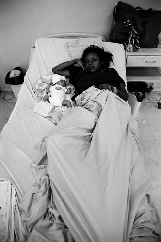 <p>&quot;This is an area of the hospital for underage girls—13 or 14-- who've just given birth. This girl looks like she's daydreaming, maybe. But I remember when I saw her, I got the feeling from her that she was overwhelmed. I didn't speak with her, but I spoke with the doctors who have a lot of concerns about underage girls with teenage pregnancies.  They try to educate them—and get the babies healthy and with their families.&quot;</p>