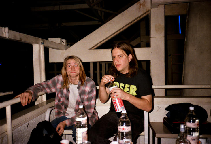 <p>Kurt Cobain and Sub Pop cofounder Jonathan Ponemon backstage at the Piper Club in Rome. Source: <a href=&quot;https://itunes.apple.com/us/book/experiencing-nirvana-grunge/id575827071?mt=11&quot; target=&quot;_blank&quot;><em>Experiencing Nirvana: Grunge In Europe, 1989</em></a></p>