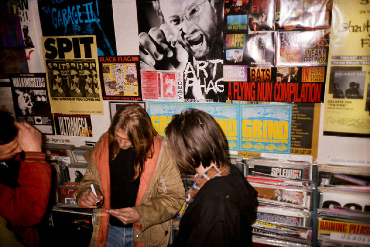 <p>Kurt Cobain signs an autograph at the Rough Trade record shop in London, 1989. Source: <a href=&quot;https://itunes.apple.com/us/book/experiencing-nirvana-grunge/id575827071?mt=11&quot; target=&quot;_blank&quot;><em>Experiencing Nirvana: Grunge In Europe, 1989</em></a></p>