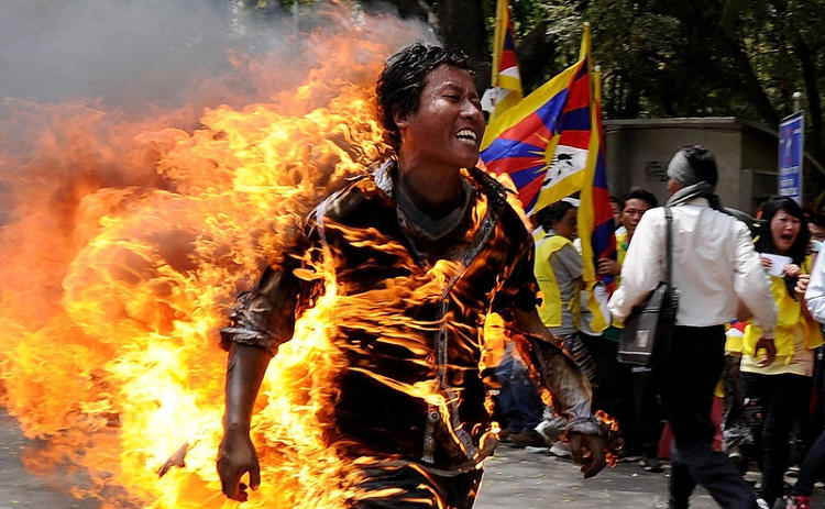 <p>A Tibetan exile commits to the ultimate protest, setting himself on fire in New Delhi on March 26, 2012, in anticipation of an upcoming visit to India by Chinese President Hu Jintao.</p>