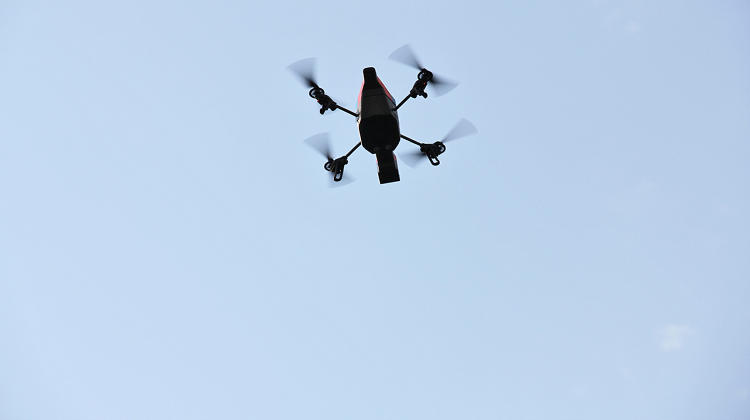 <p>A quadrotor appears in flight.</p>