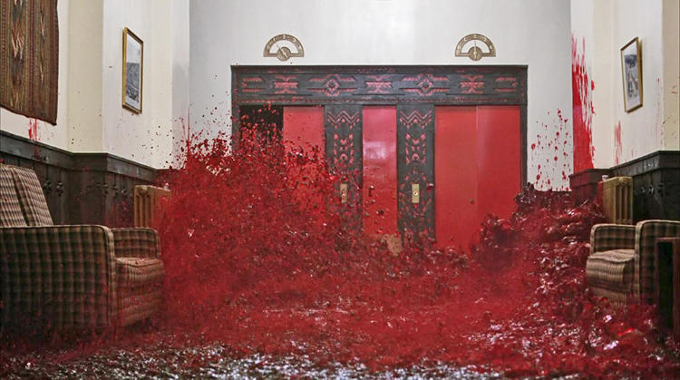 <p>The gushing blood that leaks from closed elevator doors, envisioned by clairvoyant boy Danny comes from the Indian burial site that rests beneath the hotel, as television news reporter Bill Blakemore sees it. History professor Geoffrey Cocks has an alternative interpretation: The blood represents carnage from the Holocaust.</p>