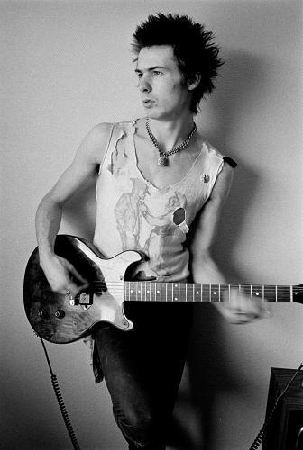 "<p>Here's The Sex Pistols' Sid Vicious, c. 1977, in a torn tee showing what curator Bolton calls ""DIY Destroy.""</p>"
