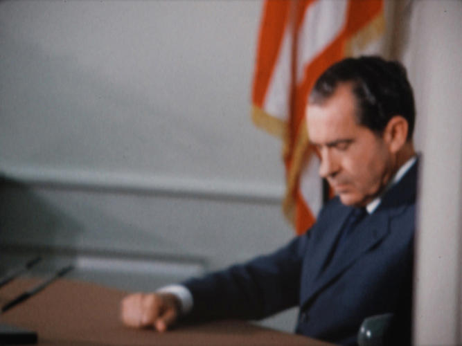 <p>President Nixon in the Oval Office preparing for his historic phone call to Apollo 11 astronauts Neil Armstrong and Buzz Aldrin, who were at that very moment landing on the moon. July 20, 1969.</p>