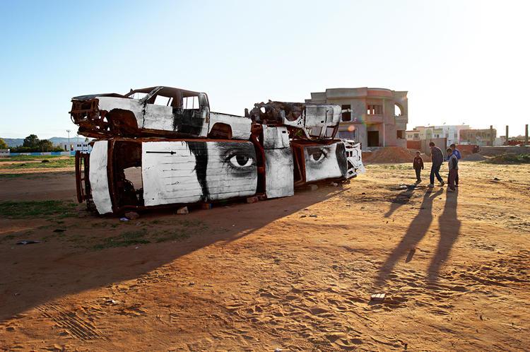 <p>Tunisia, police cars in Sidi Bouzid, 2011</p>