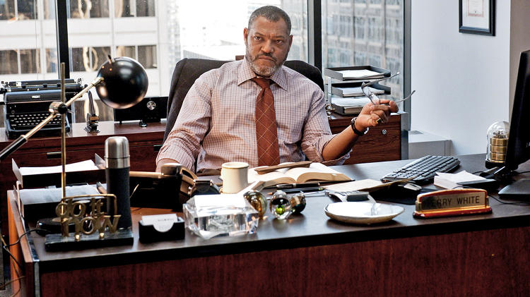 <p>Smallville isn't the only place falling on hard times. &quot;The <em>Daily Planet</em> [with Laurence Fishburne as editor Perry White, above] was not done in 1930s Art Deco. It's a contemporary newspaper, and a business in trouble,&quot; says. McDowell. &quot;Half of the desks are empty. We based it on the <em>Los Angeles Times</em>, which we scouted when it was in the middle of downsizing. We even toyed with the idea of buying some of the furniture they were selling.&quot;</p>