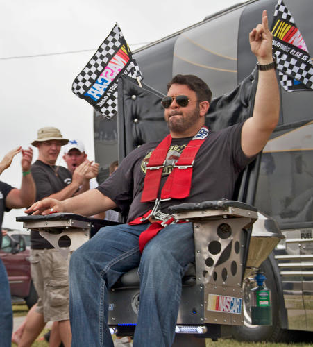 <p>Richman joins Daytona 500 superfans at a tailgate, sitting on a Mecha-Daytona chair.</p>