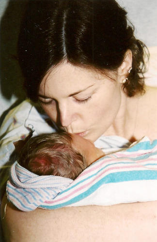 <p>Jennafer Stack with newborn daughter Michaela Hope. Her husband, Jim, was drafted from the hospital while his wife gave birth.</p>