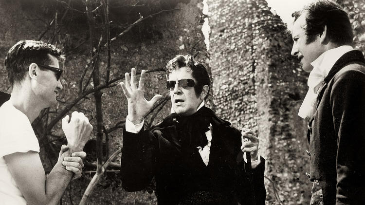 <p>Production still from <em>The Tomb of Ligeia</em> (1964), directed by Roger Corman. Corman and Vincent Price have a powwow about Poe—or perhaps just about groovy sunglasses.</p>