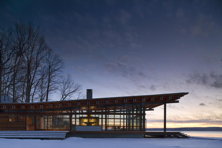 <p>Apple store architects Bohlin Cywinski Jackson created a stunning family retreat by sprinkling buildings through a forested glen at the edge of a lake in upstate New York.</p>