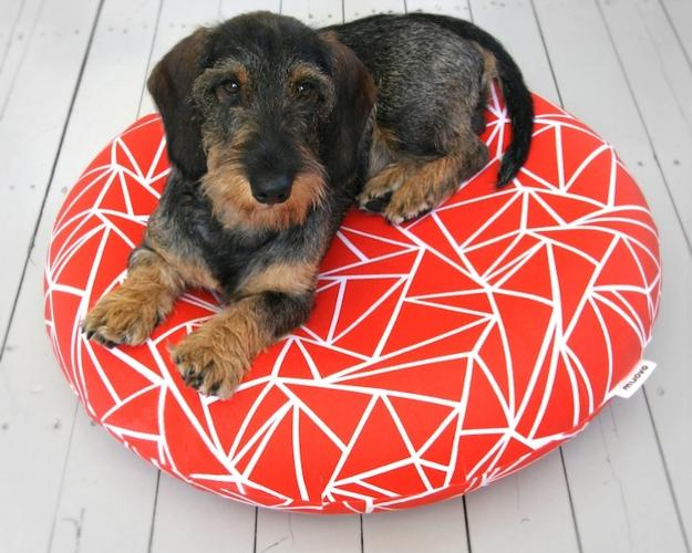 <p>Muovo, a small Finnish company, has produced a line of high-design dog beds sure to top the Christmas lists of pet owners who shop at Vitra and won't let Fido sleep on the Cassina couch. They come in several colors and cost $189 at the Finnish Design Shop.</p>