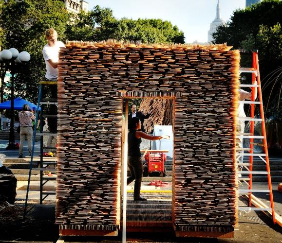 <p>Tinder.Tinker, from Sagle, Idaho created a sukkah made of the homeliest of building materials, the humble shim. In fact, 8,200 of them. Designed by David Getty, Matthew Jacobs, and Stephanie Gunawan, the Shim Sukkah will be on display at The Center for Architecture through Oct. 30.</p>