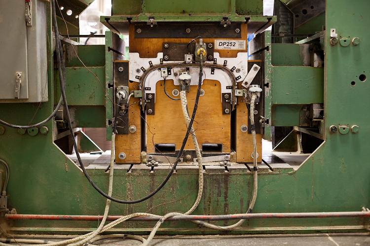 <p>The press machine that turns a bundle of veneer sheets into the back panel for an Eames lounge.</p>