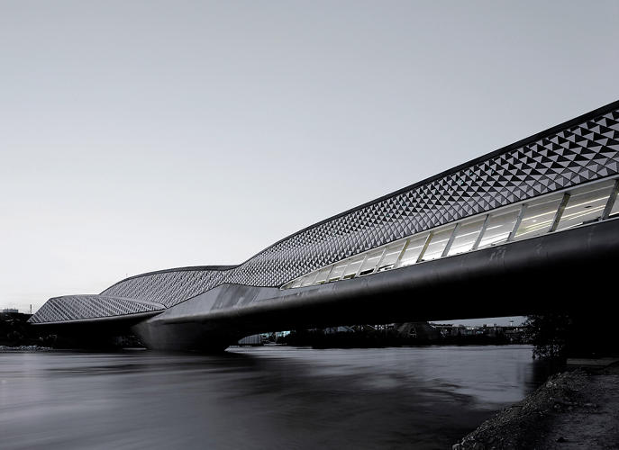 <p>The elaborate geometry of Zaha Hadid's 2008 Zaragoza Bridge Pavilion in Spain &quot;has less in common with conventional bridges than with the high-speed racing boats that pass underneath it,&quot; Blaine Brownell says. That's thanks in part to the high-performance FibreC concrete used to build the trusses. Braced with glass fibers instead of steel, FibreC lets you fabricate extremely thin panels that can adopt more complex shapes than typical steel-reinforced concrete.  Hadid's bridge features a whopping 29,000 triangular panels.</p>