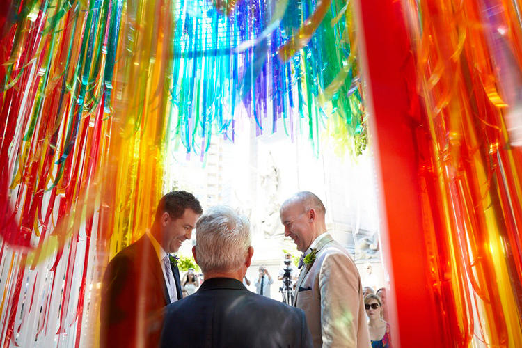 <p>This cheery, rainbow-colored pop-up structure, by Manhattan design studio iCrave, was one of two chapels built for two dozen gay weddings in Central Park on Saturday.</p>