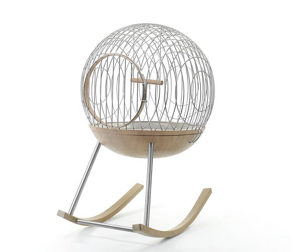 <p>Do birds like to be rocked? This birdcage is so pretty, the answer doesn't even seem to matter.</p>