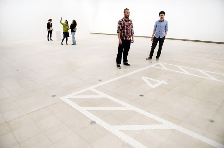 <p>Carsten Höller has applied the markings of a parking space to the gallery floor in <em>The Invisible</em>, from 1998. Visitors decided what's missing. Photo courtesy of Linda Nylind.</p>