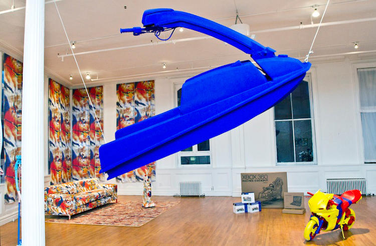 <p>The jetski hanging from the gallery's ceiling is painted in Yves Klein's iconic shade, International Klein Blue.</p>