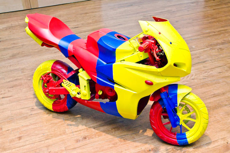 <p>A motorcycle gets a coat of paint based on Barnett Newman's abstract expressionist masterpiece, <em>Who's Afraid of Red Yellow and Blue</em>.</p>