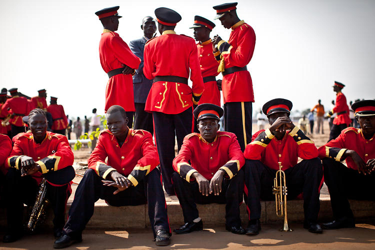 <p>Andrew Burton photographs members of the Southern Sudanese national marching band before they practice for the formal ceremonies of South Sudan's independence on July 5, 2011.</p>