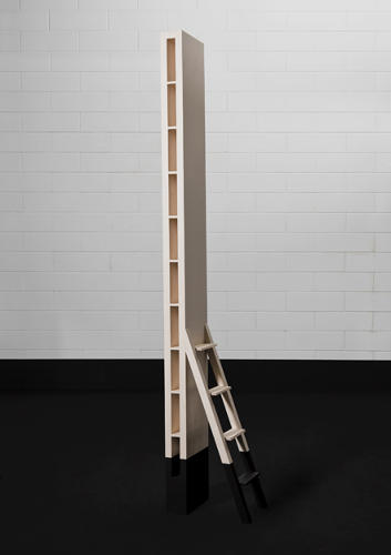 <p>A bookshelf designed for only 10 books. The short ladder, reminiscent of a traditional library ladder, serves to reach the upper shelves.</p>