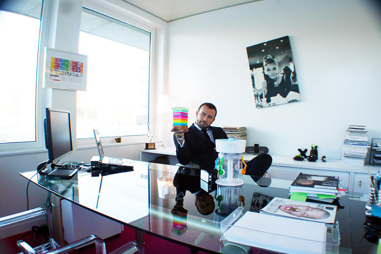 <p>Porcini at his desk at 3M. You might notice, on the wall, <a href=&quot;http://www.fastcodesign.com/1665002/infographic-of-the-day-americas-50-most-influential-designers&quot; target=&quot;_self&quot;>a certain infographic</a> we created last year.</p>