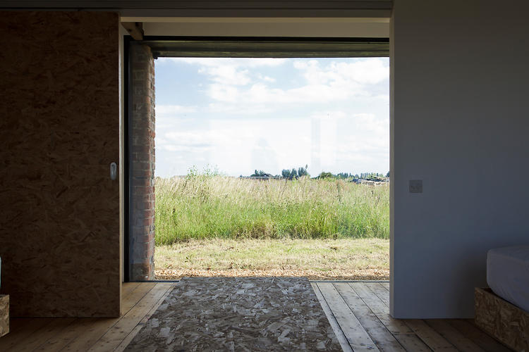 <p>Not a bad view from inside to out. Oriented strand board is a major material feature throughout the Ochre Barn.</p>