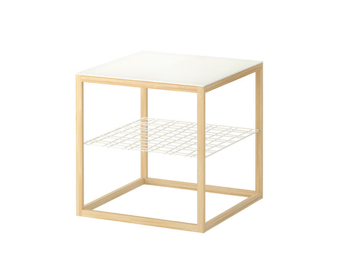 <p>This multipurpose end table can have one of three different surfaces: indented for holding fruit, or with buckets for plants or other objects. The frame is made of bamboo. $49</p>