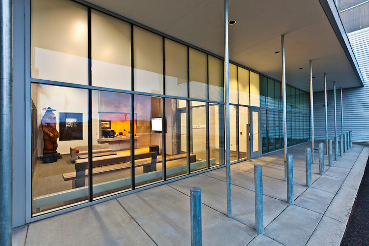 <p>The glazing surrounding the main building entry within the parking courtyard is selectively frosted or clear, as needed, to provide privacy in conference rooms and multifunction spaces.</p>