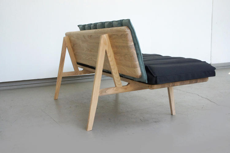<p>This ash hardwood bench, by Douglas Leckie, has three layered upholstered panels that can be configured to accommodate various restful postures.</p>