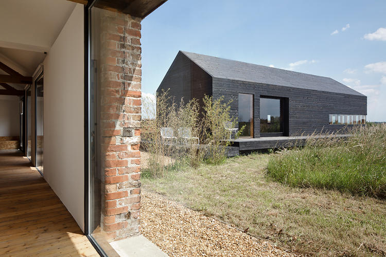 <p>Carl Turner renovated an existing 150-year old barn into a clean-lined getaway in the Norfolk countryside, and built a modern outbuilding on the property.</p>