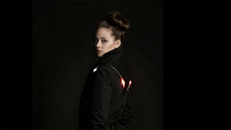 <p>Angella Mackey shows how tech, protection, and fashion can be combined into one garment: the Vega jacket, which lights up for bike safety.</p>