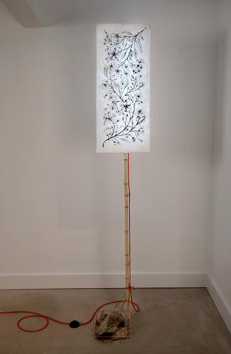 <p>Boontje screenprinted some signature floral motifs on the shade of the floor lamp.</p>
