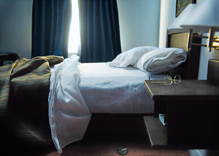 <p>One set of images from <em>Previously</em> shows a hotel room where a crime has just been committed. Finger's photos suggest that, as viewers, we'd do well to pay attention to the tiniest details (like the bedspread).</p>
