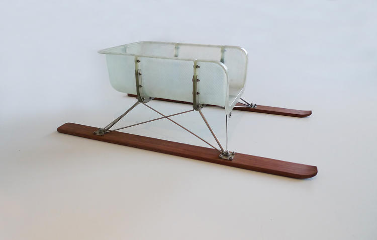 <p>Artin Aharon and Thomas Lommée built an elegant wood toboggan with Eames-inspired metal-and-wood legs.</p>