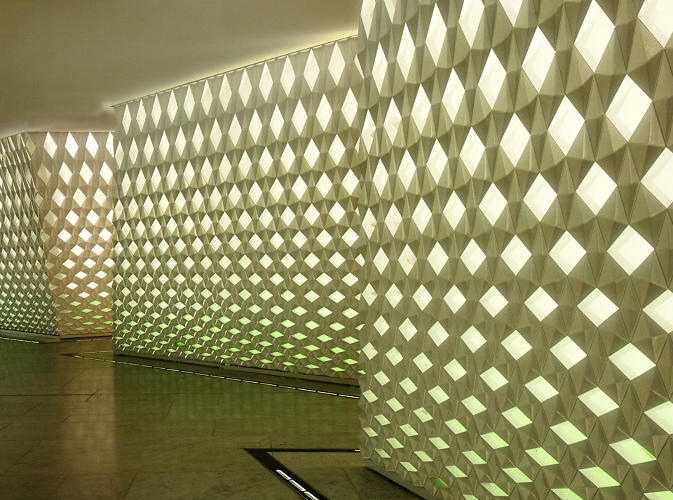 "<p>""Waves"" of natural and artificial illumination and shadows flow across the panels of repeating geometric patterns.</p>"