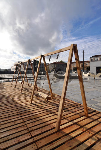 <p>Portuguese art collective Moradavaga created this swing set outside the International Centre for the Arts in Guimarães.</p>
