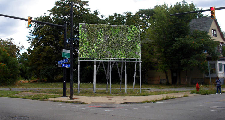 <p>Art Farms is the brainchild of David Lagé and Andrea Salvini to partner artists and urban farmers to revitalize East Buffalo. Here, Kyle Butler adapts different forms of signage and advertising into &quot;grow structures.&quot;</p>