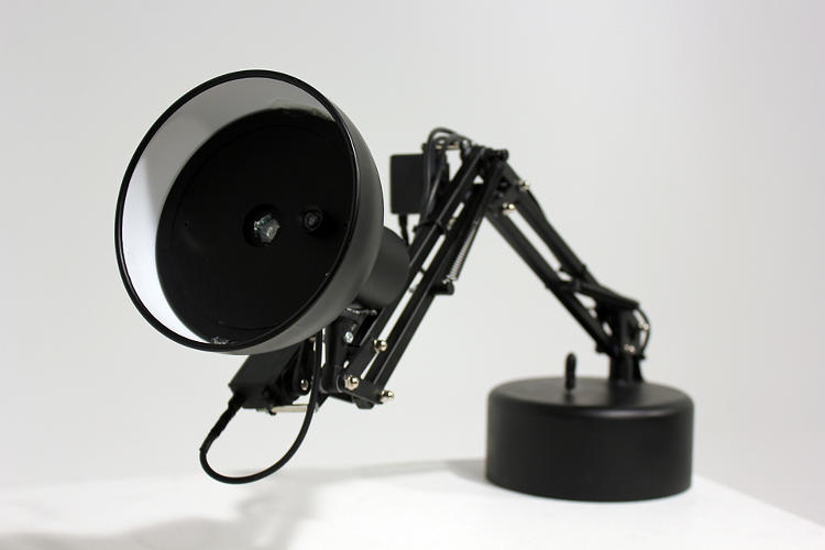 <p>The webcam tracks people's faces as they move, allowing the lamp to respond dynamically to those around it.</p>