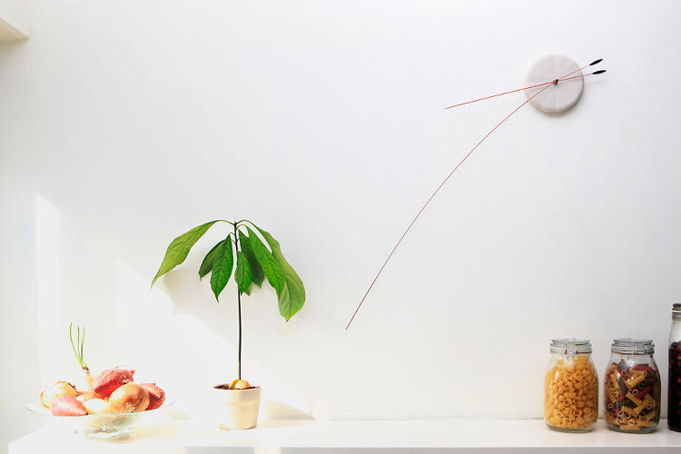 <p>The Lithe Clock, designed by the Tel Aviv-based duo Studio Ve, combines a small face with one very large minute hand.</p>