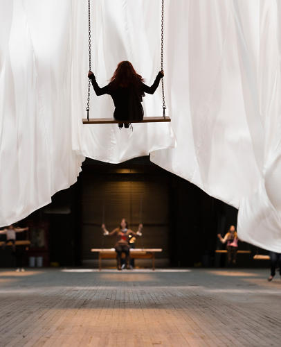 <p>The centerpiece of the show is 42 wooden swings, wide enough for two adults, attached to a spider web of ropes and pulleys 70 feet above the ground.</p>