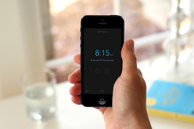 <p>Swiping a thumb up and down on the screen scrubs the &quot;clock&quot; backwards and forwards in 15-minute increments so you can set your alarm.</p>