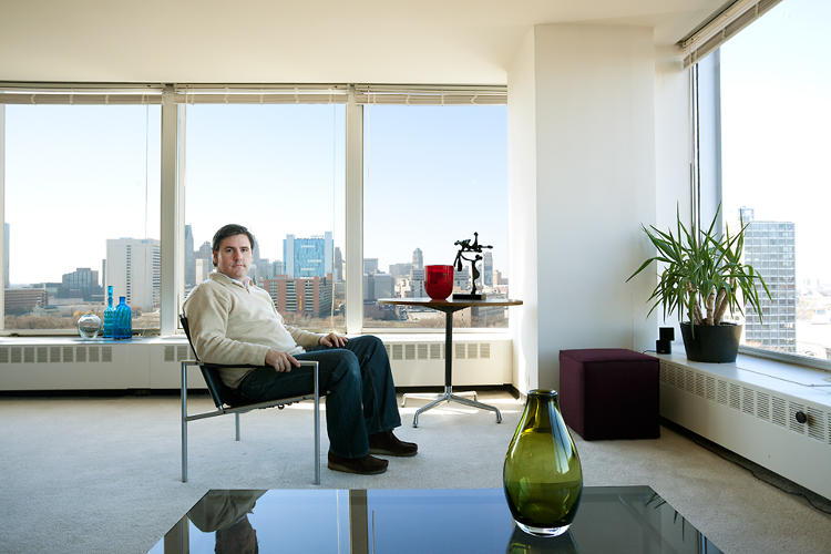<p>Joe, Lafayette Towers resident, sits in his living room. &quot;One thing that is crazy to me is that the East Tower is valued more than the West Tower,&quot; he says in the book.</p>