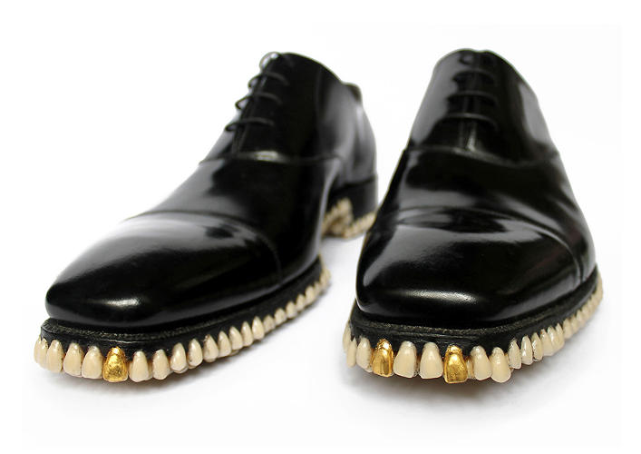 <p>The shoes are made from 1,050 individual dentures attached to a black leather upper.</p>