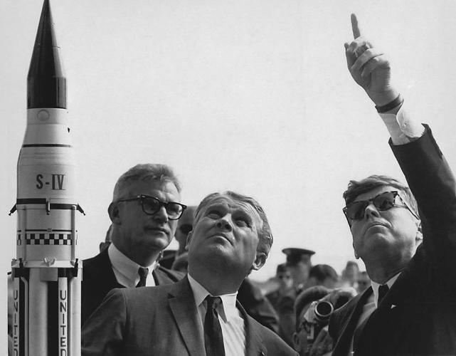 <p><strong>President Kennedy at Cape Canaveral</strong><br /> President John F. Kennedy, right, gets an explanation of the Saturn V launch system from Dr. Wernher von Braun, center, at Cape Canaveral in November 1963. NASA Deputy Administrator Robert Seamans is to the left of von Braun.</p>