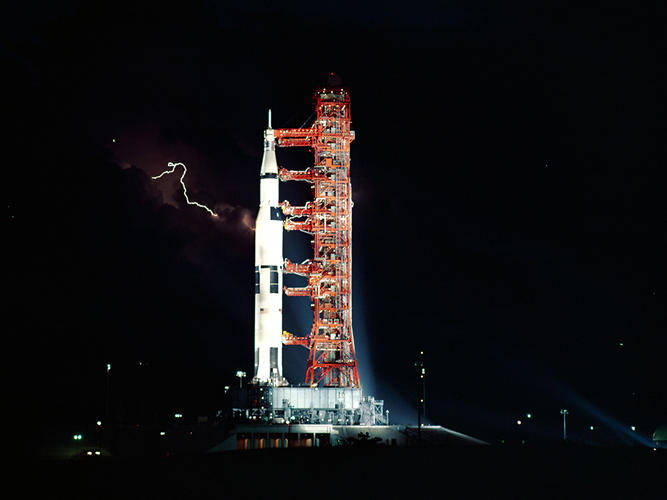 <p><strong>Lightning Launch</strong><br /> Lightning flashes in the sky behind the Saturn V rocket that will propel Apollo 15 to the moon, July 25, 1971.</p>