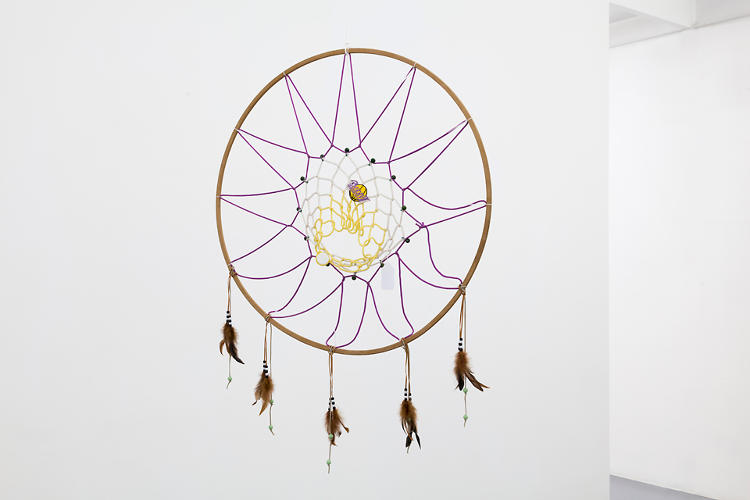 <p>The exhibition centers around the reassembly of consumer goods into surprising forms--for example, a dreamcatcher made of a basketball hoop.</p>