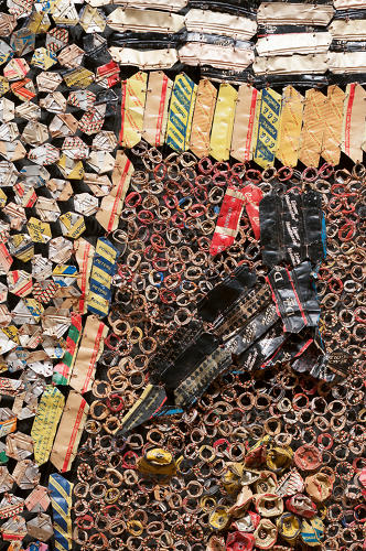 <p><em>Gli</em>, from 2010, means &quot;wall&quot; in Ewe. According to Anatsui, the piece was inspired by Berlin, Jerusalem, and Notsie, a city in Togo from which his ancestors are descended.</p>
