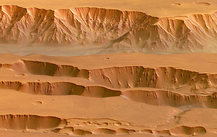 <p>A shot of the Valles Marineris canyon, which plunges over 6 miles below Mars' surface.</p>