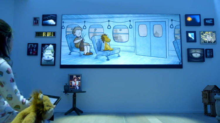 <p>And here we see the saddest moment. A little girl supposedly ignores her adorable, plush lion for a poor facsimile on a gigantic TV, surrounded by a dozen digital picture frames. Digital picture frames?? Is anyone still making those?</p>